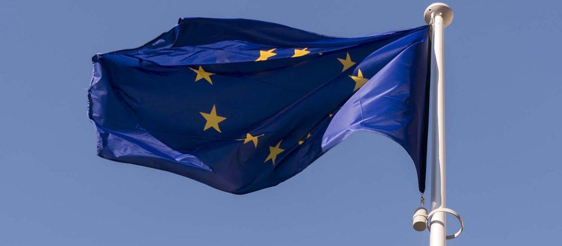 European Union flag at Berlaymont building of the European Commission in Brussels, Belgium